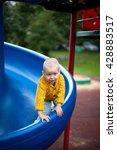 little blond boy on a play... | Shutterstock . vector #428883517
