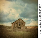 An Old Abandoned Farm House Is...