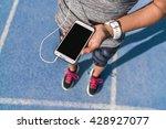runner girl holding smartphone...   Shutterstock . vector #428927077