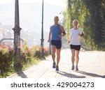 healthy mature couple jogging... | Shutterstock . vector #429004273