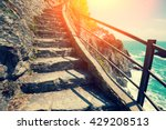 Stairways In Rock Over Sea At...