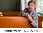 a man in a cafe drinking tea at ...   Shutterstock . vector #429227773
