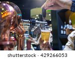barman brewing a beer tap... | Shutterstock . vector #429266053