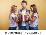 three young people with popcorn | Shutterstock . vector #429268537