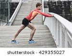 athletic young male stretching... | Shutterstock . vector #429355027