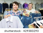 happy young pair chooses... | Shutterstock . vector #429383293