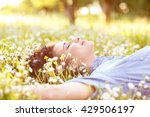beautiful young woman laying on ... | Shutterstock . vector #429506197