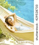 Small photo of Beautiful attractive young woman relaxing at tropical hotel in paradise ambience