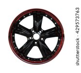 Small photo of Aluminum alloy black and red car rim with screws on a white background