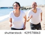 cheerful adult couple in white... | Shutterstock . vector #429578863