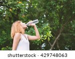 young beautiful woman drinking... | Shutterstock . vector #429748063