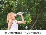 young beautiful woman drinking... | Shutterstock . vector #429748063
