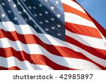 photo of american flag waving... | Shutterstock . vector #42985897