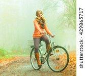 happy active woman riding bike... | Shutterstock . vector #429865717