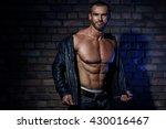 muscular man in leather jacket... | Shutterstock . vector #430016467