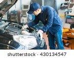 mechanic working in his workshop | Shutterstock . vector #430134547