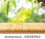 wood floor with blurred trees... | Shutterstock . vector #430285963