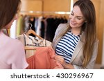 woman shopping in a boutique  | Shutterstock . vector #430296967