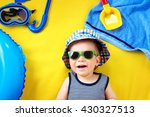 Little Boy With Sunglasses In...