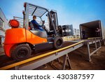 forklift is putting cargo from... | Shutterstock . vector #430387597