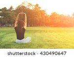 young woman practicing yoga at... | Shutterstock . vector #430490647