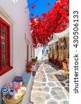 A Narrow Street With Flower...