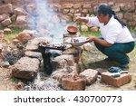 Latin Woman Cooking Barbecue