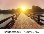Wooden Bridge Over Lake In...
