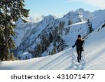 A Hiker Tours Through Snow In...