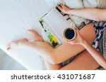 young woman lying in bed...   Shutterstock . vector #431071687