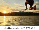 Young Man Jumping Into The Lak...