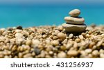 Stack Of Three Rocks On A...