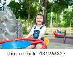 Asian Baby Girl Playing On A...
