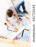 guy making mark on apartment... | Shutterstock . vector #431723143