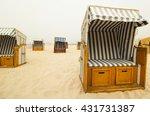 basket chairs on a foggy beach  ... | Shutterstock . vector #431731387