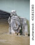 Small photo of PARIS, FRANCE - JUNE 4: Paris flood with high water on June 4, 2016 in Paris, France. People looking the Zouave statue on the Alma Bridge #2