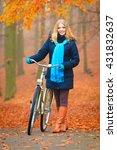 happy active woman riding bike... | Shutterstock . vector #431832637