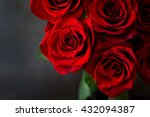 Bouquet Of Red Roses On A Blac...