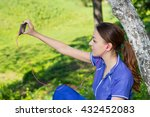 female jogger is smiling and... | Shutterstock . vector #432452083