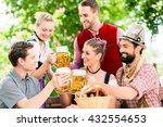 friends in bavarian beer garden ... | Shutterstock . vector #432554653