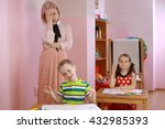 the teacher in the class with a ... | Shutterstock . vector #432985393