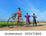 happy young local boy riding... | Shutterstock . vector #433171843