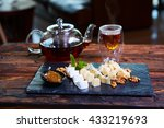 various cheeses and tea on a...   Shutterstock . vector #433219693