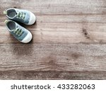 Cute Little Baby Shoes On Wood...
