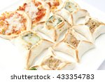 mix of pizzas on a dish  white... | Shutterstock . vector #433354783