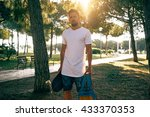 young guy in a blank white t... | Shutterstock . vector #433370353