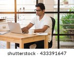 young indian man working from...   Shutterstock . vector #433391647