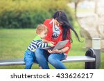 mother and daughter using... | Shutterstock . vector #433626217