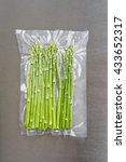 Small photo of Green asparagus sealed in an airtight plastic bag ready for sous vide cooking