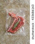Small photo of Lamb chop sealed in an airtight plastic bag ready for sous vide cooking